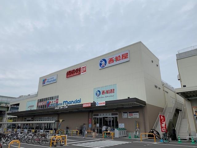 万代堺高須店
